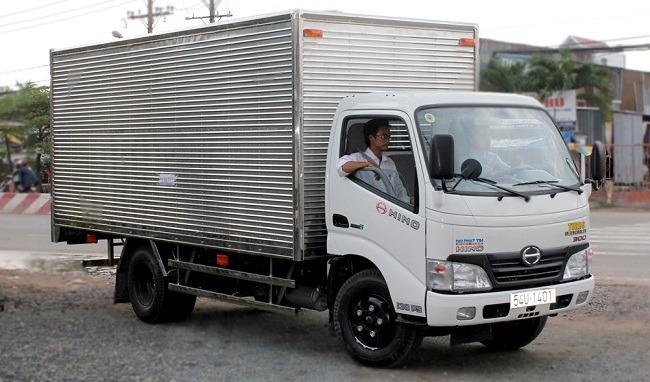 Mua bán xe tải hino 5T2/ 5,2 tấn mới 100% thùng dài 5m7 cao 2m4 = hino 5T2/ 5,2 tấn mới 100%
